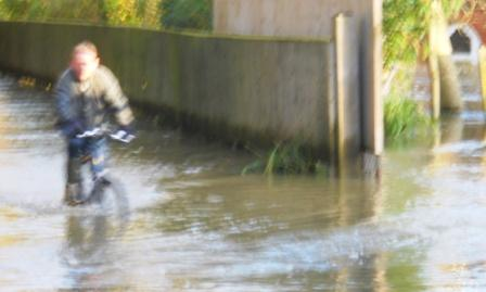 Cyclist in Flood Henley Mill Lane